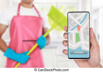 hand ordering cleaning service via mobile phone