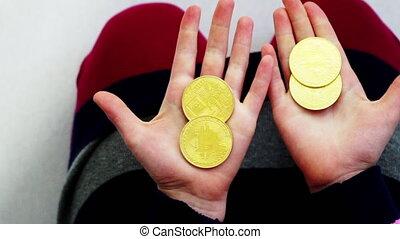 close-up girl counts  golden bitcoin 1