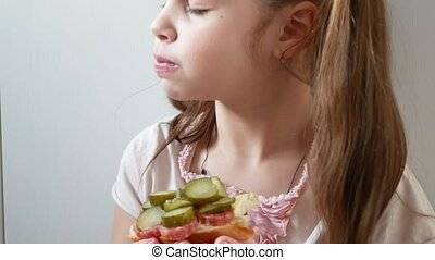 Close Up Girl eating sandwich in kitchen - Close Up Girl...