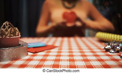 Close up girl pushing a red heart into camera, sweet love symbol