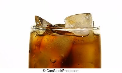 Close up glass of cola with ice cubes on white