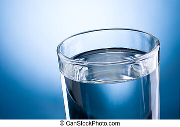 Close-up glass of water on a blue background