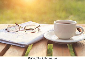 Close up glasses on newspaper and Coffee on the table in the...