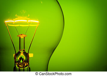 glowing light bulb - Close up glowing light bulb on green ...