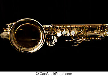 sax - close up gold alto saxophone on black background