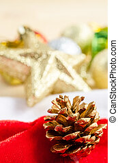 Close up gold pine cones with christmas decorations.