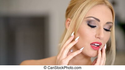 Close up Gorgeous Blond Woman Touching her Face