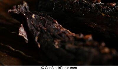 Close-up Gourmet Beef Jerky in the dark.