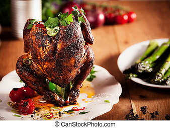 Gourmet Grilled Whole beer can Chicken on a White Plate