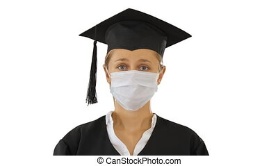 Graduate student lady in a medical mask looking to camera on white background.