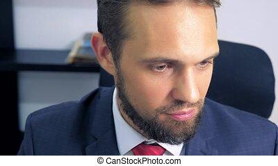 close-up, green-eyed handsome man wistfully looks around.