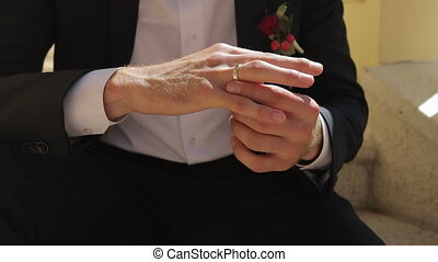 Close-up Groom Hands with Ring and Cufflink