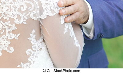 Close up groom's touches to his bride. Slowly