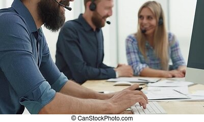 group employees analyzing business statistics and communicating with each other in the workplace .