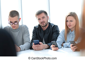 group of young people sitting at a round table