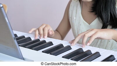 Close up hand a children playing piano and clap