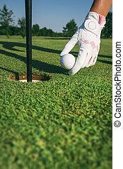 Close-up hand hold golf ball