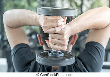 Close-up Hand holding dumbbell
