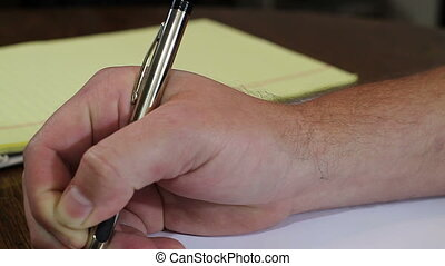 Hand writing with fancy pen - Close up Hand writing with...