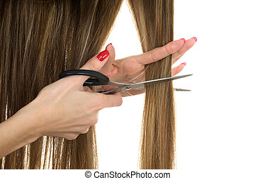 scissors trying to cut long hair - Close-up hands holding ...