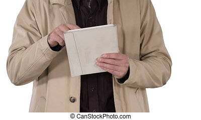 Hands of man using tablet on white background.