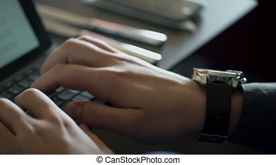 Close up hands of man working on laptop inside office job indoors