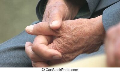 Close up hands of old man.