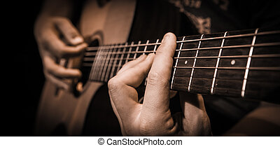 Close up hands on the strings of a guitar - Close up of...
