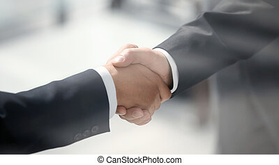close up. handshake business people in a modern office