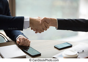 Close up handshake of two boss ceo male and woman