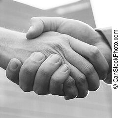 handshake - close up handshake with blue office building in ...