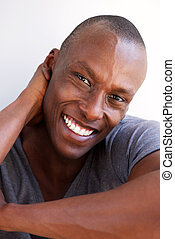 Close up handsome african american man smiling with hand behind head