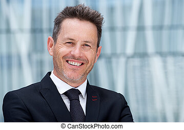 Close up handsome businessman smiling in suit and tie