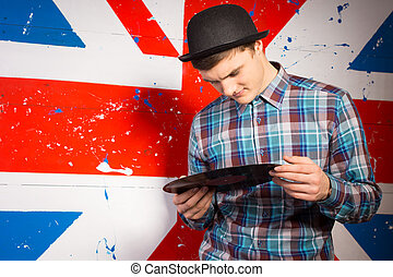 Man in Trendy Outfit Holding Vinyl Record Plate