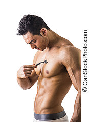 Handsome Muscled Young Man Shaving his Chest