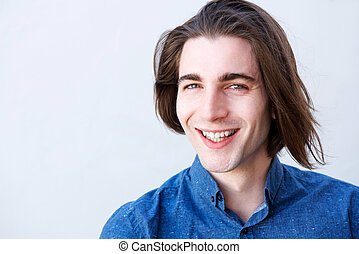 Close up handsome young man smiling with long hair