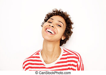 Close up happy african american woman laughing by white background