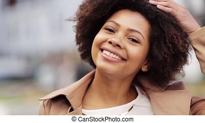 close up happy african american woman outdoors - people,...