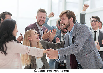 happy employees congratulating each other on the victory.
