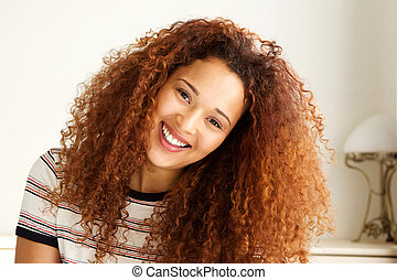 Close up happy young african american woman smiling
