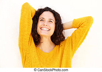 Close up happy young woman smiling with hands behind head