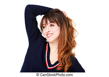 Close up happy young woman with hand in hair against isolated white background