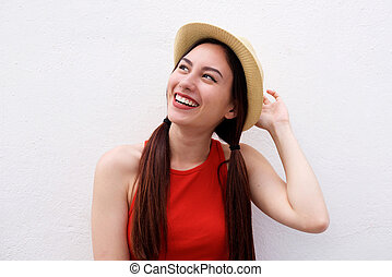 Close up happy young woman with hand to hat on white background