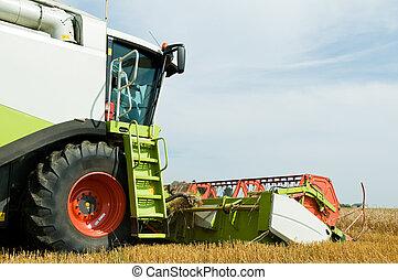 close-up harvesting combine