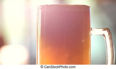 Close up head of beer pouring.