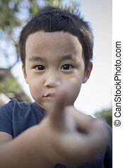 close up head shot of asian children face playing happiness
