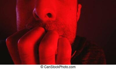 Close up headshot portrait man with nervous facial...