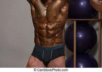 Close-Up Healthy Man With Six Pack - Serious Man Standing ...