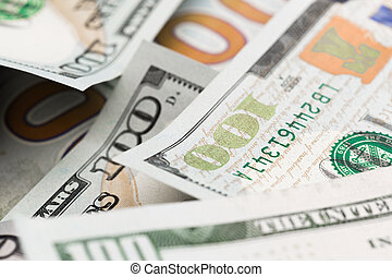 Close up heap of one hundred dollars, selective focus. Dollars, the us money background.