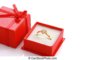 Close up heart shaped ring in red gift box isolated on white with copyspace